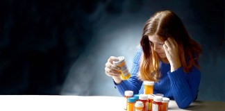 Woman with pills and medicines
