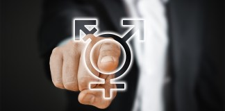 Male hand turning swithch of genders