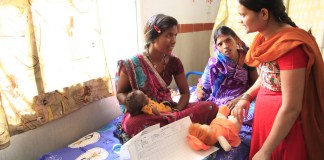 India, a health worker explains the importance of breastfeeding