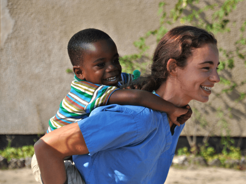 An elective student with a child in Tanzania
