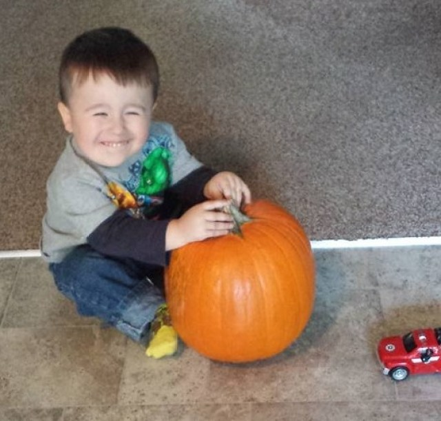 Alley son with pumpkin
