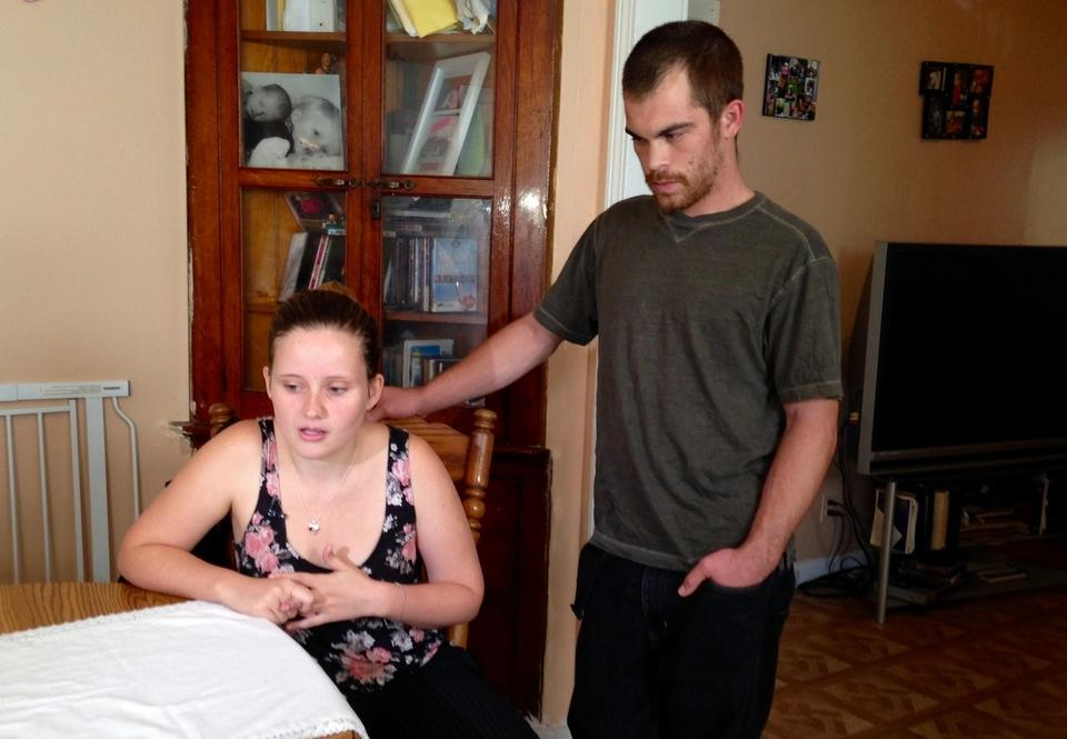 "Kirsten Fauquet and John Stratzman, in their apartment in New London on Oct. 5, 2016, talk about their son ""Dylan,"" who nearly died in a Groton foster home. (Deborah Straszheim/The Day)"