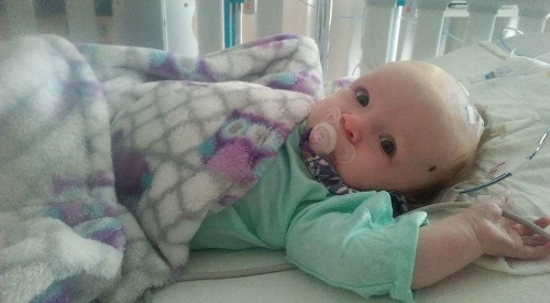 Kelsey baby in hospital eyes open