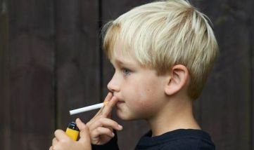 Kid smoking a cigarette with lgihter