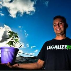 brazilian medical cannabis campaigner with cannabis plant
