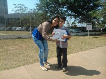 Child and mother collecting medical marijuana prescription