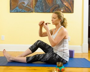 Woman-smoking-pot-and-doing-yoga