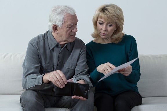 couple comparing notes to see if they need to sign up for Medicare