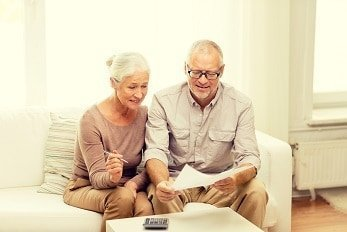 Couple deciding if they need to sign up for Medicare