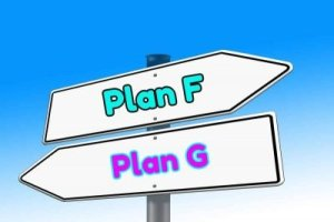 Sign pointing one way for Plan F vs Plan G in another direction