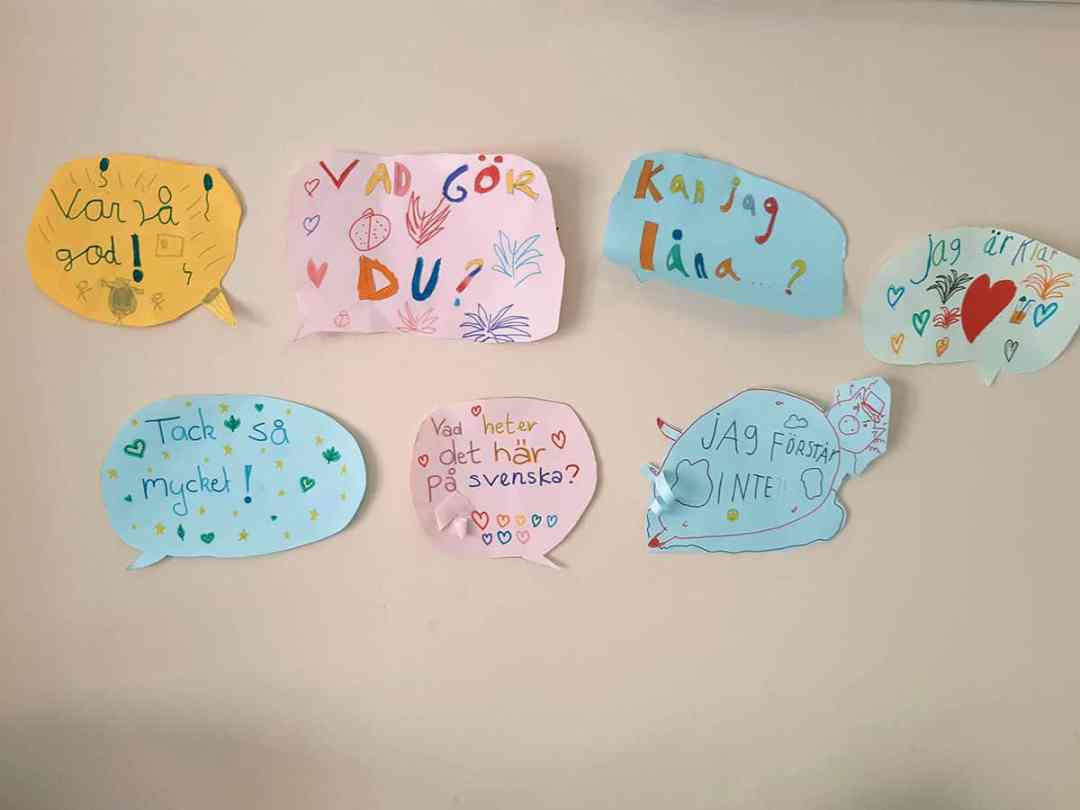 Paintings and drawings with Swedish phrases from the childcare on campus