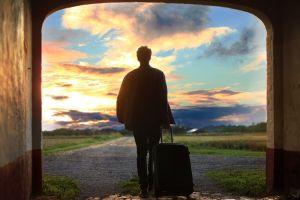 Man suitcase moving to sunset Denmark
