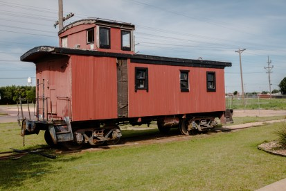 Old caboose adjoining the building