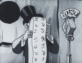 A figure in a top hat stands in front of a microphone, reading a scroll in Japanese script.