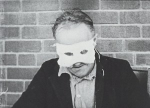 A patient wearing a white mask.