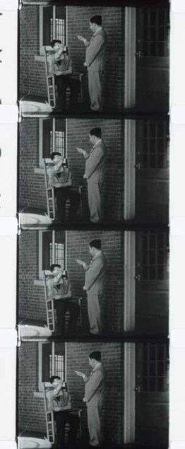 Frames of 16mm film stock shows an attendant manipulating the limbs of a catatonic patient.