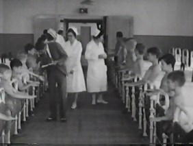 Doctors and nurses inspect the children in a dormitory