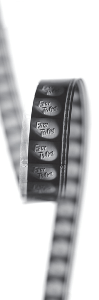 A photograph of part of the original 16mm film strip showing the title frame for Easy To Get.