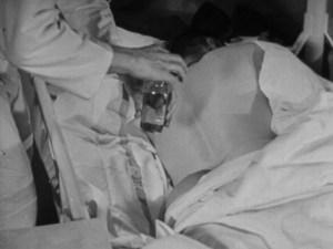 A man prepares a patient for a backrub.