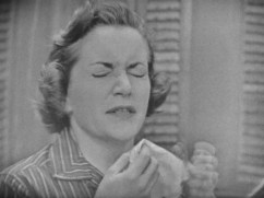 woman about to sneeze with a napkin up to her face