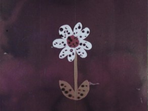 White flower with black spots all over