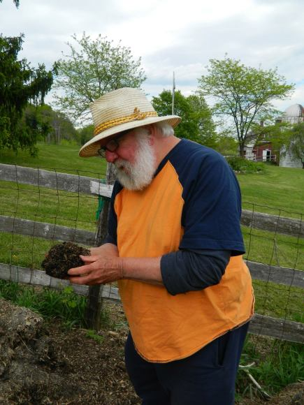 Brian Hennessey with compost in hands