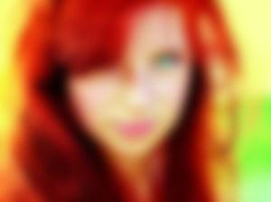 highly saturated headshot of storyteller Meg O'Ryan