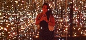 photo of Jacque Donaldson in a Yayoi Kusama infinity room