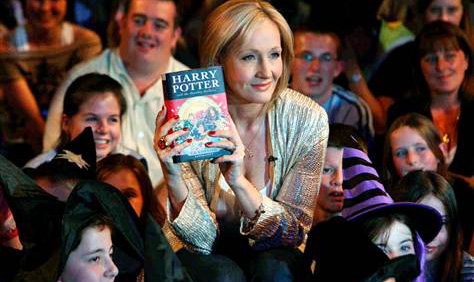 author J. K. Rowling giving a talk to a group of learners