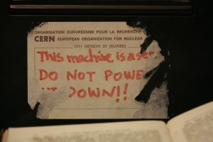 "photo of Tim Berners-Lee's NeXT Cube with a ""server, do not power down"" sticker on it"