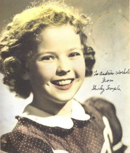 Portrait photo of Shirley Temple autographed to Andy Warhol