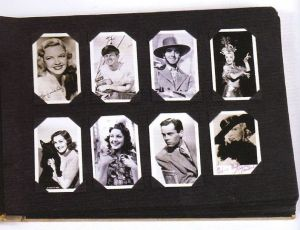 a page from Andy Warhol's childhood scrapbook showing 8 celebrity photographs set in 2 rows
