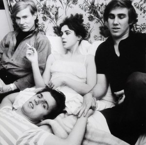 May 1, 1965: Andy, Edie, Chuck & Gerard in bed in a Paris hotel while waiting for Andy's Flowers show to open at Gallery Sonnabend.