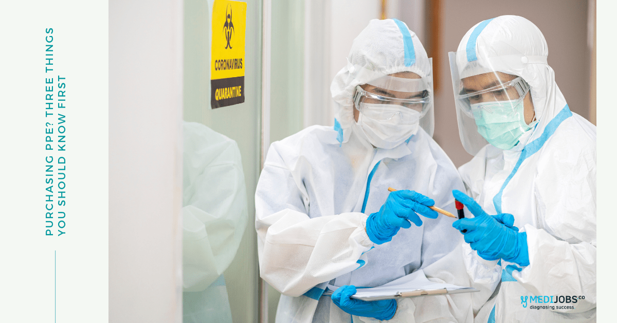 Doctors wearing PPE while looking a blood sample in a clinical setting