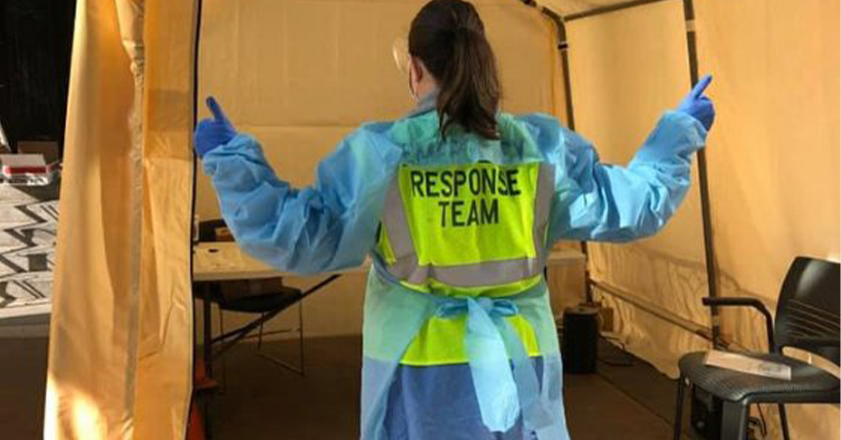 Woman standing in response team gear at hospitals hiring for corona covid-19 virus. MEDIjobs