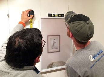 "Tommy and Doug make sure Murray's work is level and at a standard gallery height of 60 inches at the middle of the piece. ""It's both an art and a science,"" Doug says. ""There are the technicalities of hanging the work, but then there's an art to making it look good."""