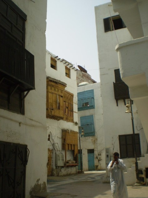 An image of a man walking through a residential area in the old city of Jeddah, Saudi Arabia.