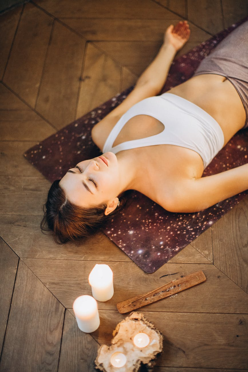 woman relaxing in yoga mat