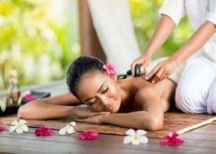 woman getting a massage as part of a self care routine