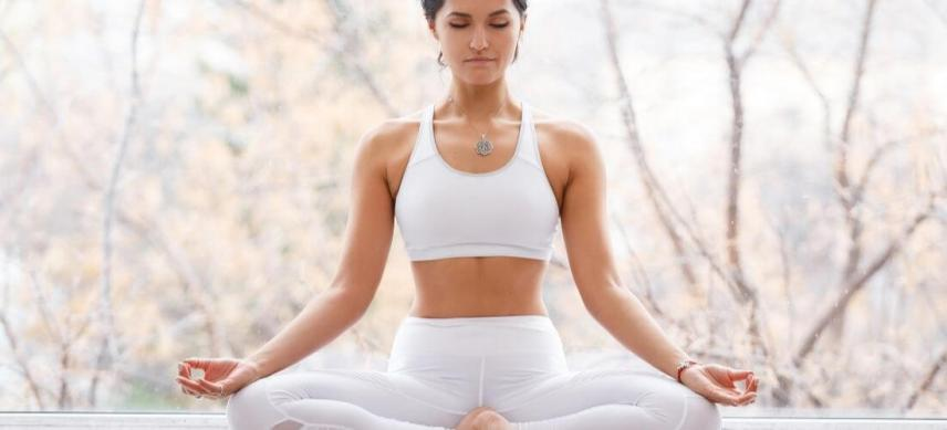what is meditation woman meditating with nature background