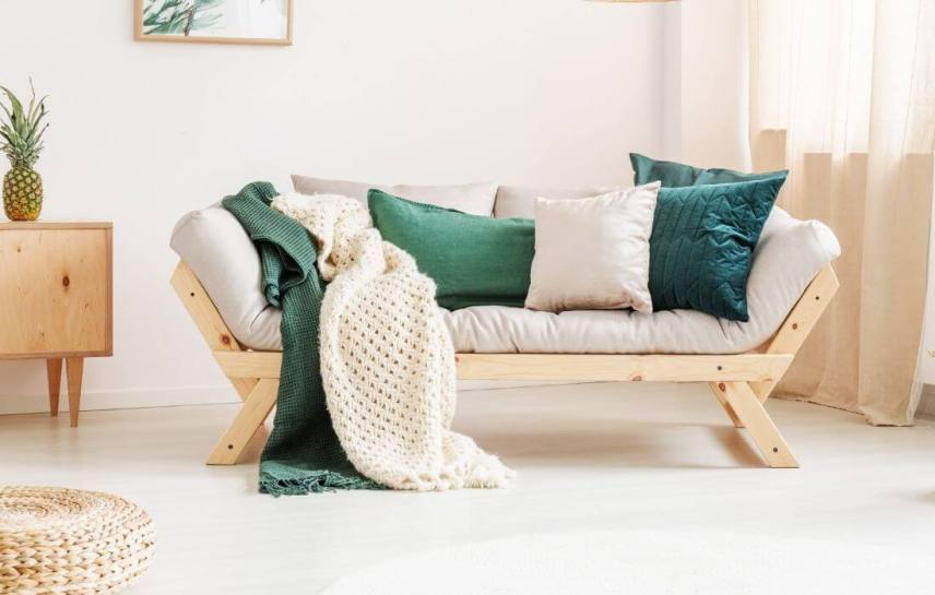 relaxing room with a meditation cushion and sofa