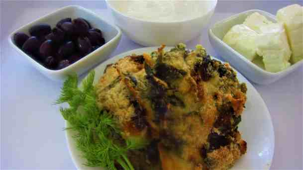 Spinach Corn Pie Casserole (Shapkat) served with feta cheese, greek yogurt and calamata olives.