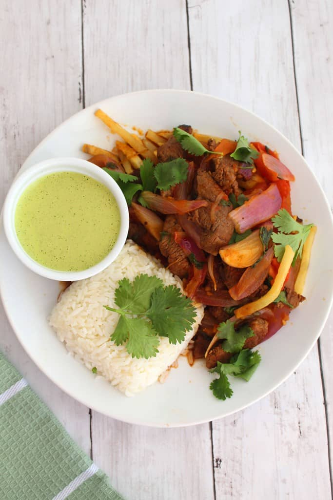 Peruvian Lomo Saltado served with Salsa Verde and Rice
