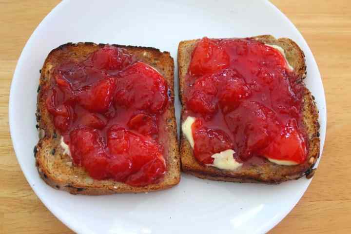 Toasted bread with butter and homemade red plum jam.