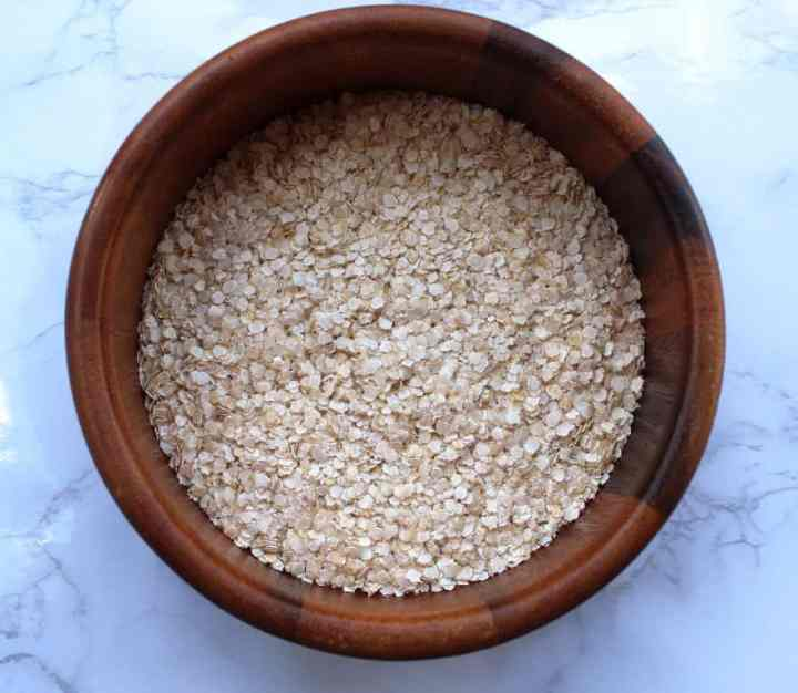 A bowl of Uncooked Quinoa Flakes