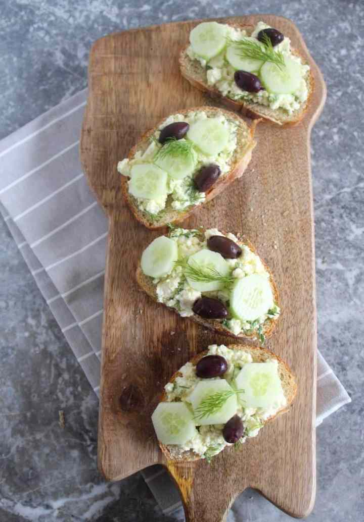 Mediterranean crostini served with feta cheese, olive oil, kalamata olives, cucumbers and fill.