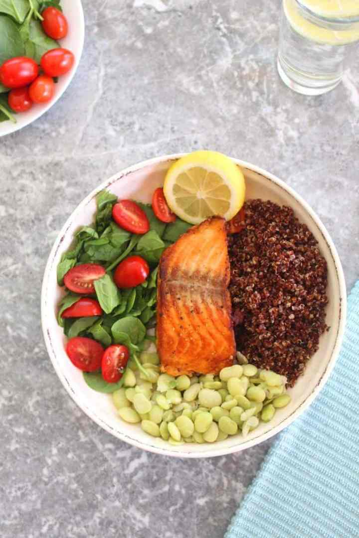 Salmon Red Quinoa Bowl with Green Lima Beans, Spinach and Grape Tomatoes.