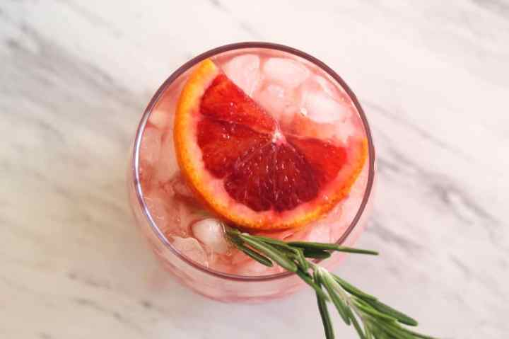 Vodka Cocktail with Blood Oranges and Rosemary, served over crushed ice.