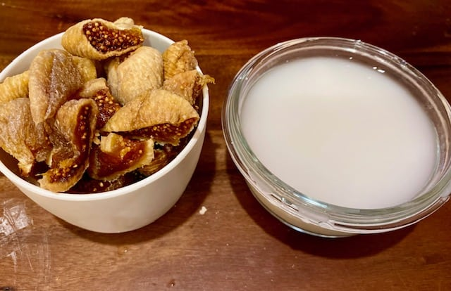 Chopped dried figs in one container and diluted starch in water  in another container.