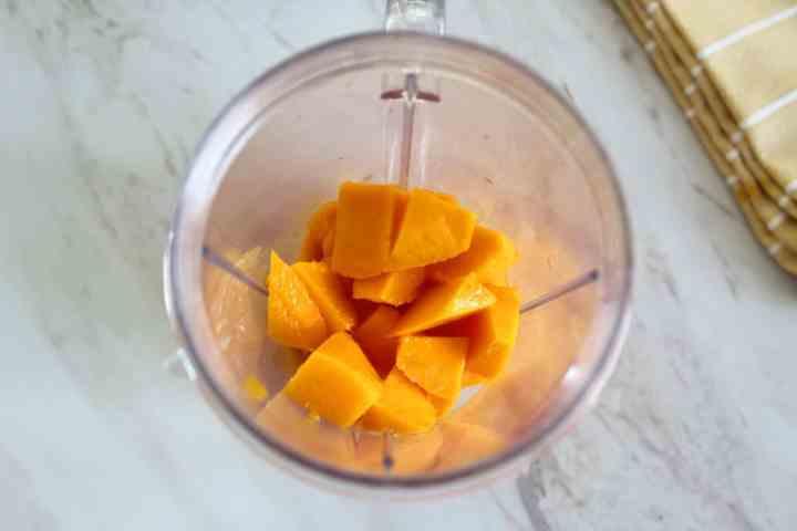 Chopped fresh mango into a blender